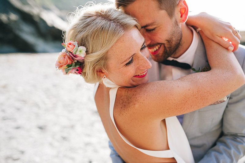natural and relaxed wedding photo at tunnels beaches