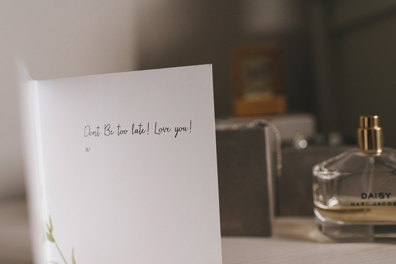 "A card saying ""don't be late! love you!"""