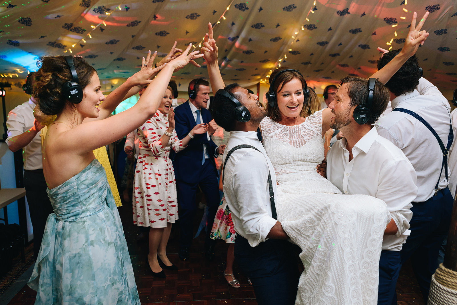 Bride celebrating with friends during silent disco at Roscarrock Farm Wedding in Cornwall