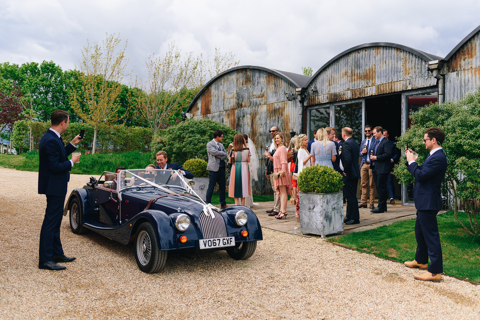 Wedding guests outside Cripps Stone Barn in the Cotswolds