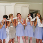 Emotional photograph of bridesmaids reaction to seeing the bride