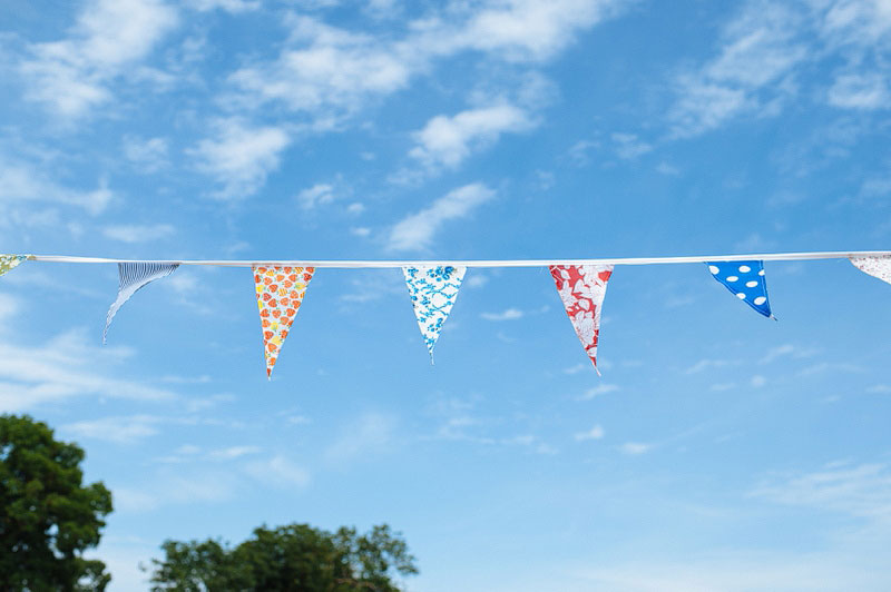 Home made bunting against a blue sky