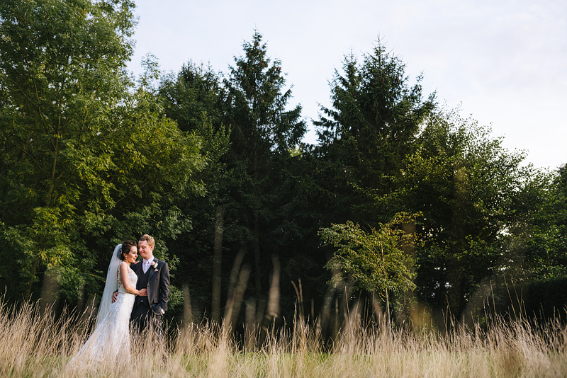 Great fosters Wedding Portrait in the long grass