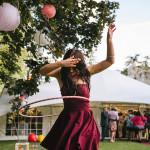 girl hula hooping at festival wedding